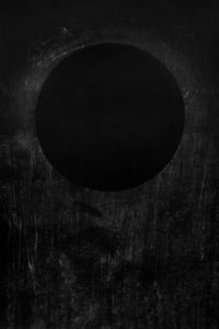 Abstract large format print. Reminiscent of a low lying solar eclipse over a field