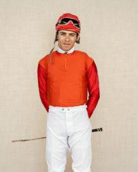A young Jockey photographed Hipódromo de San Isidro in Buenos Aires, Argentina.